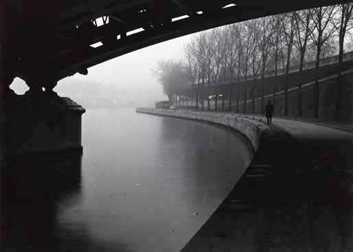 Willy Ronis, Man Walking along the Seine-